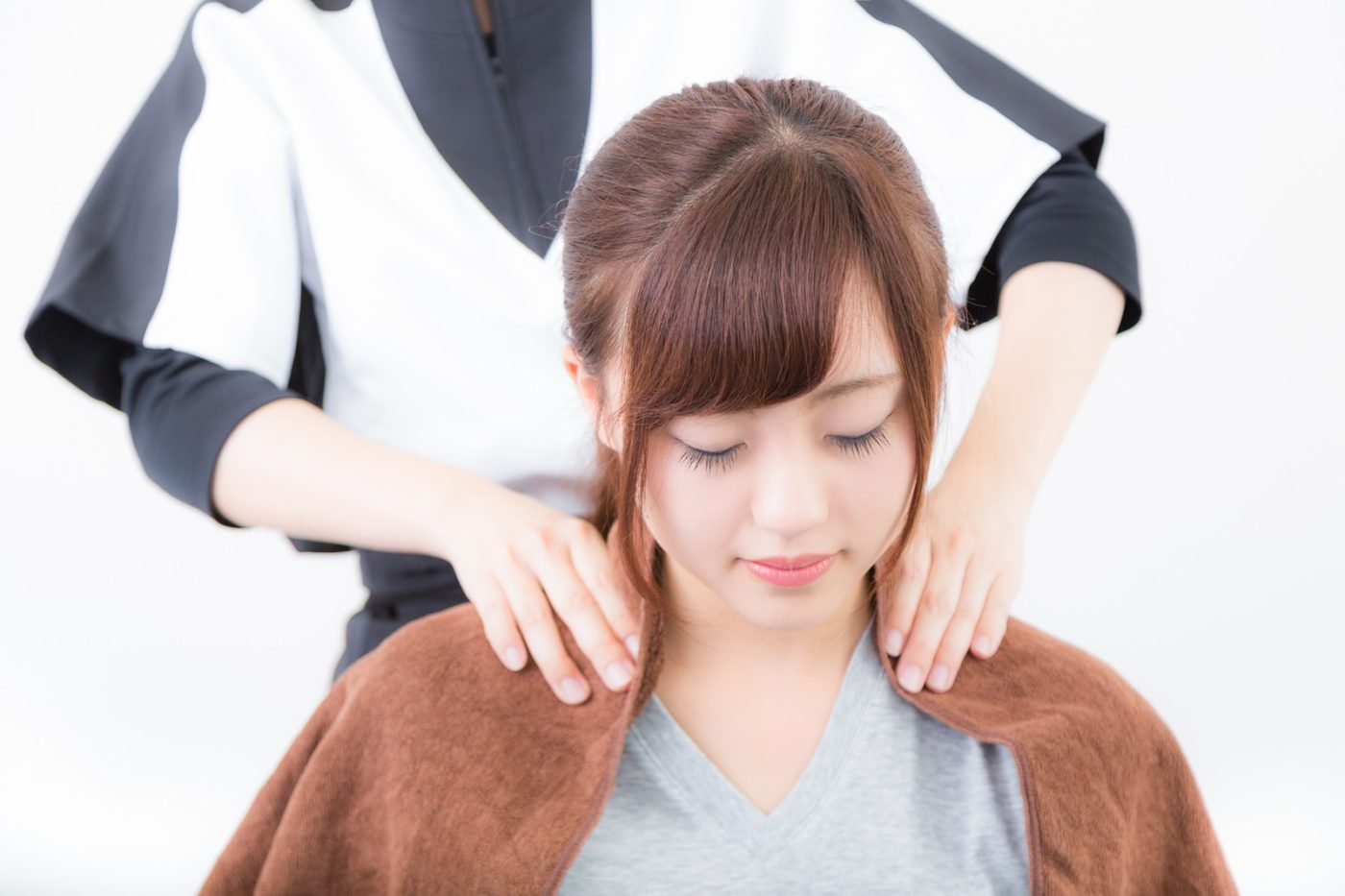 肩こりに悩む女性